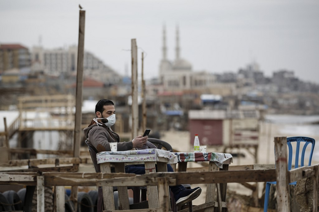 A man with a face mask in Gaza