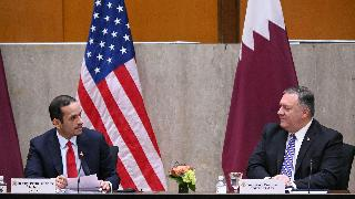 US Secretary of State Mike Pompeo(R) welcomes Qatar's Deputy Prime Minister Mohammed bin Abdulrahman Al Thani to launch the third annual US-Qatar Strategic Dialogue at the State Department in Washington