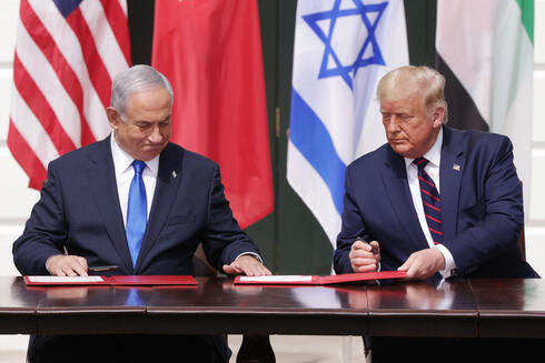 (L-R) Prime Minister of Israel Benjamin Netanyahu and U.S. President Donald Trump participate in the signing ceremony of the Abraham Accords