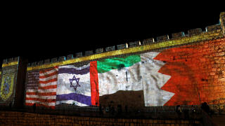The flags of the United States, Israel, United Arab Emirates and Bahrain are projected onto the walls of the Old City of Jerusalem to mark the signing of the Abraham Accords, Sept. 2020