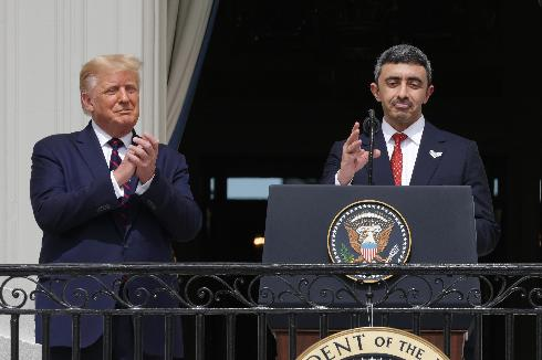 Foreign Affairs Minister of the United Arab Emirates Abdullah bin Zayed bin Sultan Al Nahyan speaks as U.S. President Donald Trump looks on during the signing ceremony of the Abraham Accords