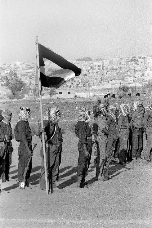 In this file photograph taken on August 17, 1970, militiamen of El Fatah Palestinian resistance movement, parade in Amman, Jordan, at the end of a training session chaired by Yasser Arafat, President of the Central Committee of the Palestinian National Council