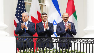 US President Donald J. Trump (L) speaks as (2L-R) Israeli Prime Minister Benjamin Netanyahu, UAE Foreign Affairs Minister Sheikh Abdullah bin Zayed bin Sultan Al Nahyan and Bahrain Foreign Affairs Minister Sheikh Khalid Bin Ahmed Al-Khalifa during the Abraham Accords signing ceremony