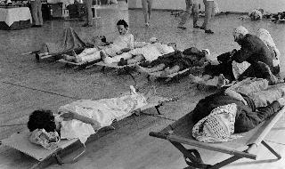 In this file photo taken on October 02, 1970 Wounded Palestinians coming from the Palestinian refugee camp of Wihdat wait at the French field hospital in Amman, on October 02, 1970