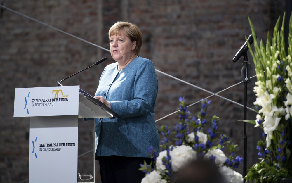 Chancellor Angela Merkel speaks at the ceremony to mark the 70th anniversary of the Central Council of Jews in the courtyard of the New Synagogue in Berlin, Germany