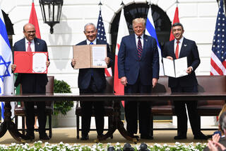 (L-R)Bahrain Foreign Minister Abdullatif al-Zayani, Israeli Prime Minister Benjamin Netanyahu, US President Donald Trump, and UAE Foreign Minister Abdullah bin Zayed Al-Nahyan during their signing ceremony at the White House