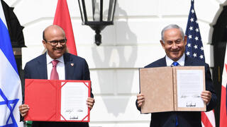 Bahrain FM Abdullatif al-Zayani and PM Benjamin Netanyahu at the signing of the Abraham Accords at the White House, Sept. 2020
