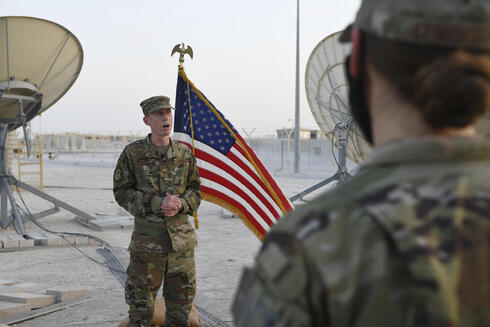U.S. Air Force, Col. Todd Benson, the U.S. Air Force Central Command director of space forces, addresses members of the 379th Operations Support Squadron before they are sworn in as members of the Space Force at Al-Udeid Air Base, Qatar