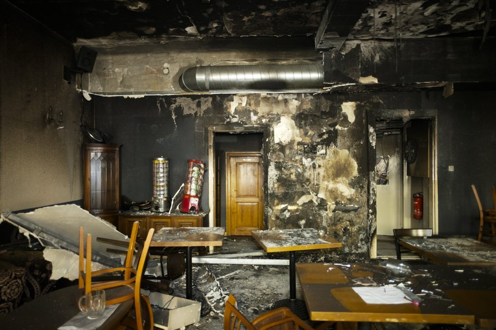 Tables and chairs stand in the burned out Jewish-run bar 'Morgen wird Besser' (Morning will be better) in Berlin, Germany