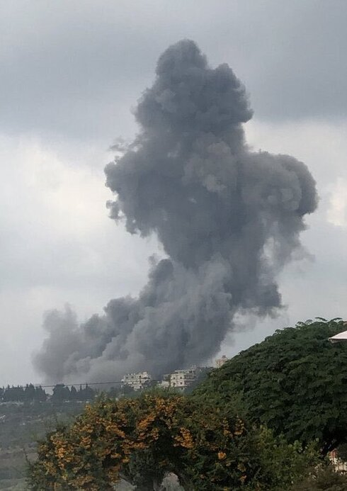 Smoke rising from the scene of the explosion in Ein Qana