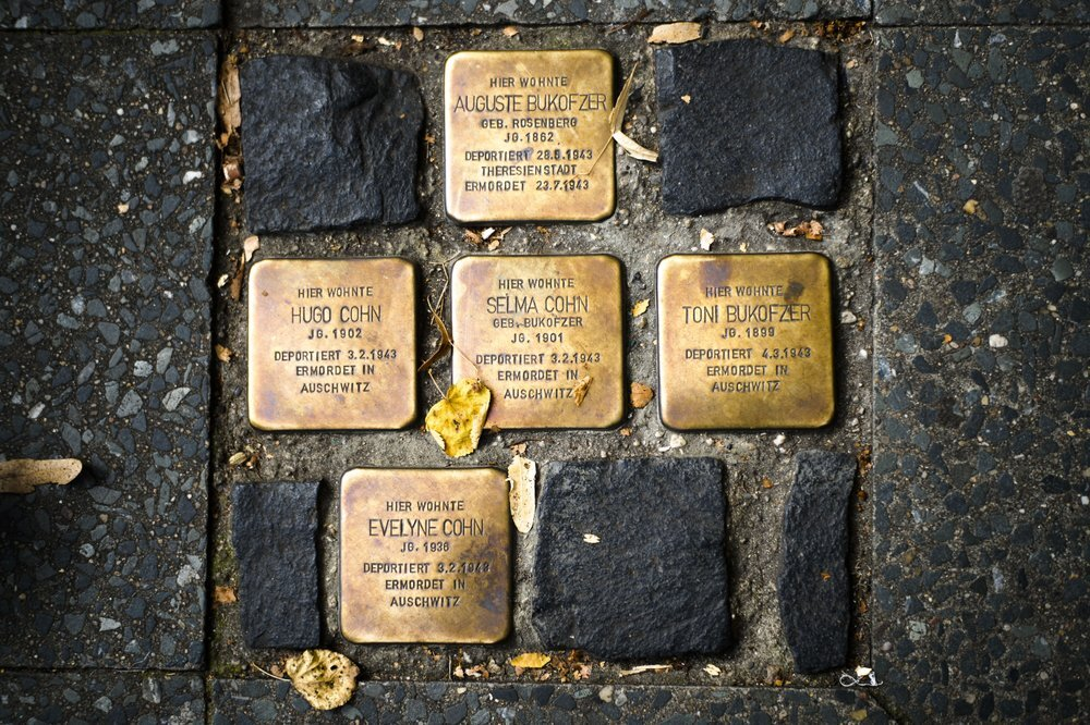 So called stumbling blocks, marking the last voluntarily chosen places of residence of the victims of the Nazis, are embedded in the pavement in Berlin, Germany