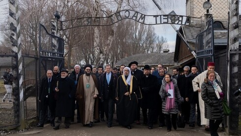 A delegation led by Mohammed al-Aissa, a former Saudi minister and the general secretary of the Muslim World League, visiting Auschwitz