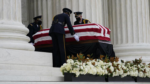 The flag-draped casket of Justice Ruth Bader Ginsburg lies in repose at the Supreme Court building