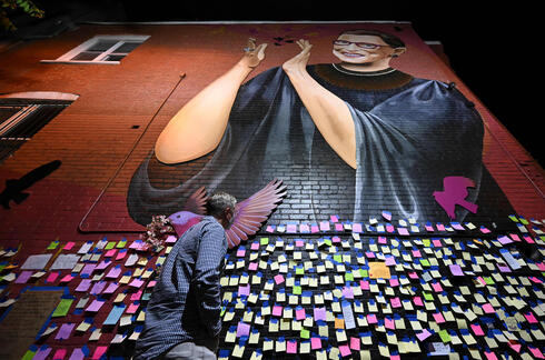 messages of thanks and gratitude taped on a mural memorial to late Supreme Court Justice Ruth Bader Ginsburg in downtown Washington