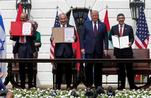 Bahrain's Foreign Minister Abdullatif Al Zayani, Israel's Prime Minister Benjamin Netanyahu and United Arab Emirates (UAE) Foreign Minister Abdullah bin Zayed display their copies of signed agreements while U.S. President Donald Trump looks on as they participate in the signing ceremony of the Abraham Accords