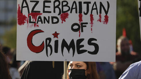 Armenians who live in Greece take part in a rally in Athens against Azerbaijan