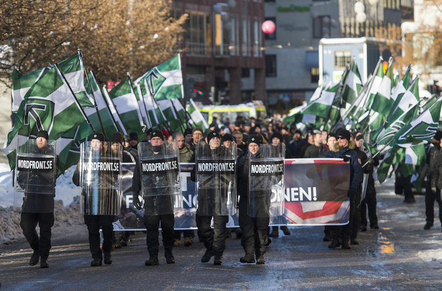 Nordic Resistance Movement sympathizers participating in an anti-immigrant demonstration in central Stockholm