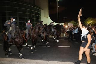 Protesters face off against mounted police in central Tel Aviv on Saturday night