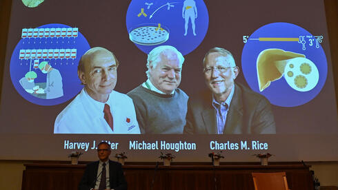 the Nobel Committee, speaks to announce the winners of the 2020 Nobel Prize in Physiology or Medicine (On screen L-R) American Harvey Alter, Briton Michael Houghton and American Charles Rice,