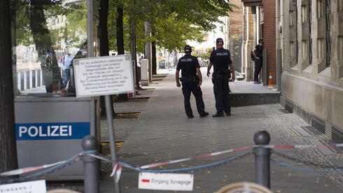 Police patrol in front of the 'New Synagogue' at Oranienburger Strasse in Berlin, Germany