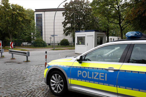 A police car stands in front of the Synagoge 'Hohe Weide' in Hamburg, northern Germany