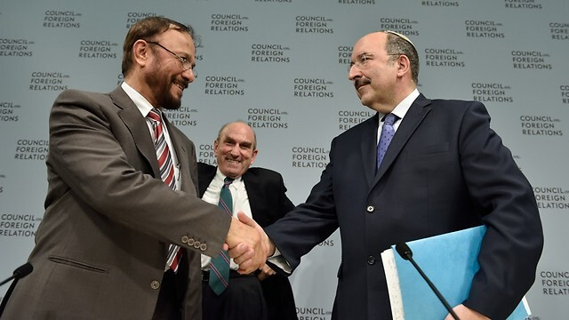 Saudi Maj. Gen. (ret.) Anwar Eshki shakes hands with then-Foreign Ministry chief Dore Gold after sharing the stage at a conference in Washington in 2015