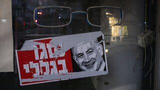 """A poster reads """"closed because of me """" with an image of Israel's Prime Minister Benjamin Netanyahu on a closed shop in Tel Aviv, Israel"""