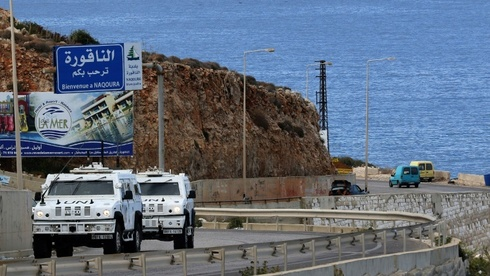 UN peacekeepers patrol the coast road near Naqura, the last town in Lebanon before the border with Israel