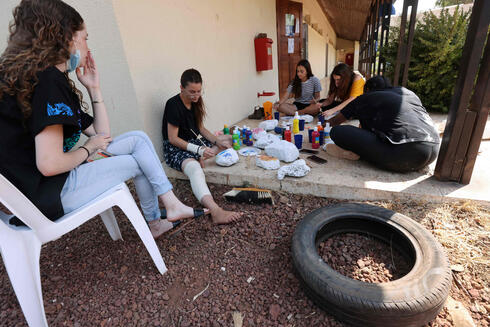 Israeli teenagers take part in camp activities at Trump Heights, an Israeli settlement in the Israeli-occupied Golan Heights on September 21, 2020, where they are put through a six-month programme ahead of national service