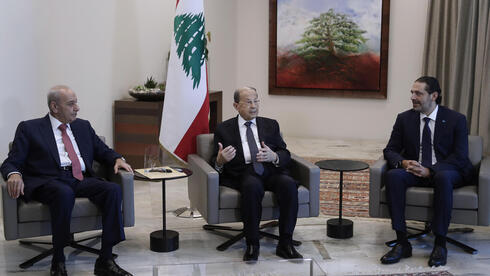 Lebanese President Michel Aoun (C) during his meeting with Lebanese parliament speakers Nabih berri (L)and lebanese Prime Minister-designate Saad Hariri (R)