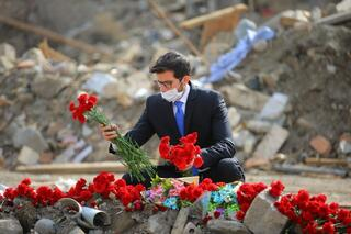 Israeli Ambassador to Azerbaijan George Dick lays flowers on bombsites where civilians have lost their lives in the city of Ganja during the Nagorno-Karabakh conflict