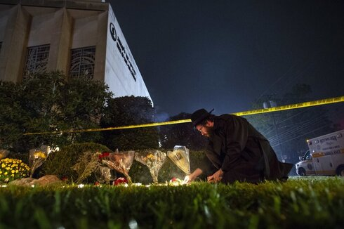 Rabbi Eli Wilansky lights a candle after a mass shooting at Tree of Life Synagogue in Pittsburgh's Squirrel Hill neighborhood