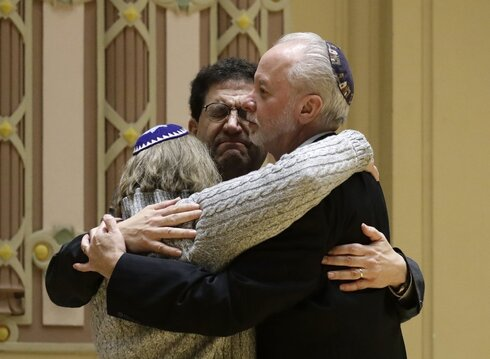Rabbi Jeffrey Myers, right, of Tree of Life/Or L'Simcha Congregation hugs Rabbi Cheryl Klein, left, of Dor Hadash Congregation and Rabbi Jonathan Perlman during a community gathering held in the aftermath of a deadly shooting at the Tree of Life Synagogue in Pittsburgh