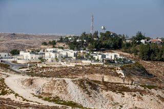 The Israeli settlement Shimaa south of the city of Hebron in the West Bank and the Palestinian village of Samua in the background
