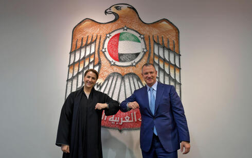 Emirati Minister of State for Food and Water Security Mariam al-Muhairi (L) and Erel Margalit