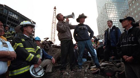 U.S. President George W. Bush talks to rescue workers in the wreckage of the World Trade Center in NY after the Sept. 11, 2001 attacks