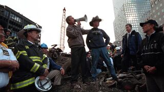 U.S. President George W. Bush talks to rescue workers in the wreckage of the World Trade Center in New York after the Sept. 11, 2001 attacks