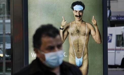 Bus stop ad for 'Borat 2' featuring actor Sacha Baron Cohen, ahead of its release on October 23