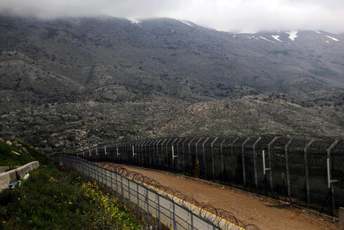 Fences are seen on the ceasefire line between Israel and Syria in the Israeli-occupied Golan Heights