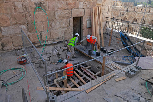 Workers renovate the Tower of David Museum near the Jaffa Gate entrance to the Old City of Jerusalem, Oct. 28, 2020
