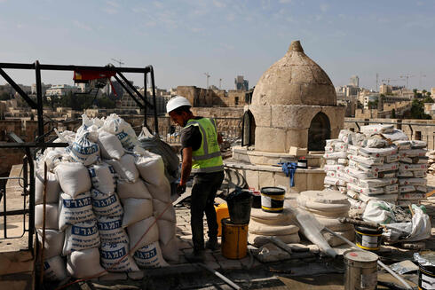 Workers renovate the Tower of David Museum in the ancient citadel of Jerusalem near the Jaffa Gate entrance to Jerusalem's Old City on October 28, 2020