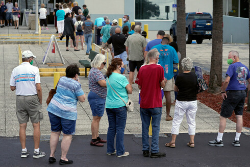 People line up at a Florida polling station to cast their early ballots