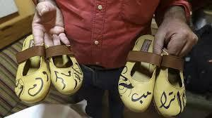 Handcrafted footwear with the names of the US and French presidents in Arabic calligraphy to show disapproval of them