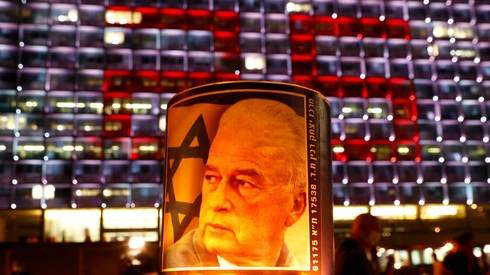 A poster of assassinated prime minister Yitzhak Rabin during a memorial rally in Tel Aviv on Saturday