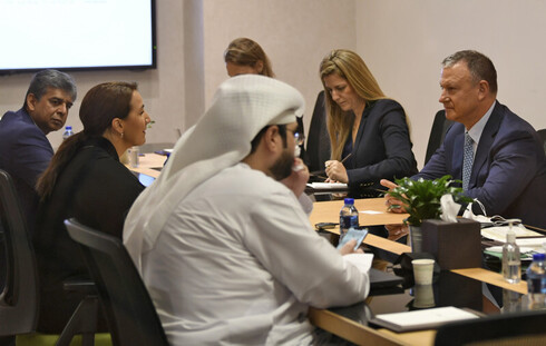 Emirati Minister of State for Food and Water Security Mariam al-Muhairi (L) meets with Erel Margalit, founder and chairman of Jerusalem Venture Partners (JVP), at the headquarters of the Government Accelerators in Dubai