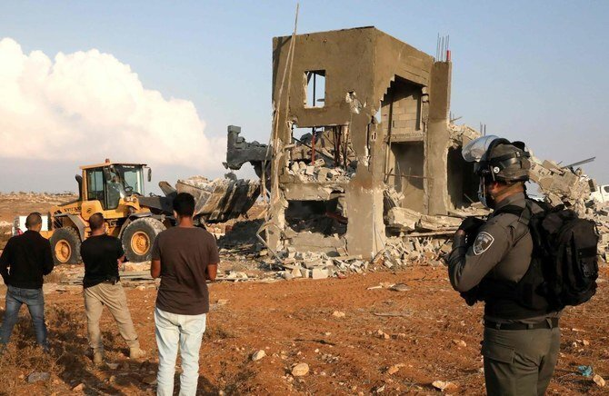 Israeli machinery demolish a Palestinian house located within the area C (where Israel retains control, including over planning and construction) near Yatta in the southern area of the West Bank town of Hebron