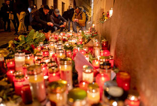 People light up candles outside Vienna's main synagogue, near the site of a terrorist attack in the Austrian city, November 4, 2020