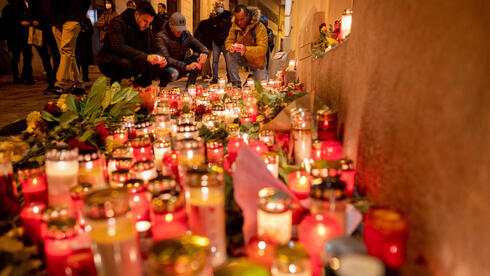 People light up candles outside Vienna's main synagogue near the site of the terrorist attack in Vienna, Austria on November 4, 2020