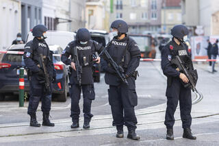 Armed Austrian police officers during a raid at a mosque in Vienna, Austria