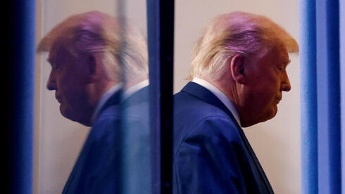 U.S. President Donald Trump is reflected as he departs after speaking about the 2020 U.S. presidential election results in the Brady Press Briefing Room at the White House in Washington
